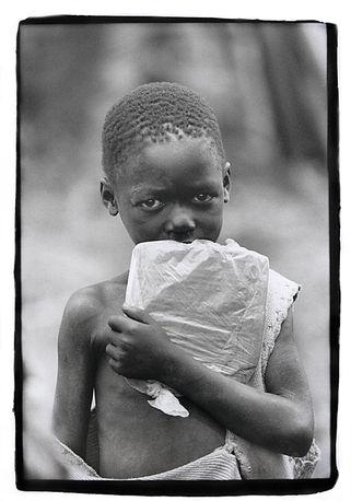Boy with precious school books, Southern Sudan