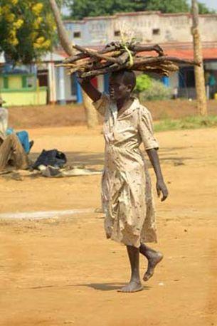 Woman carrying wood, Moyo, Northern Uganda