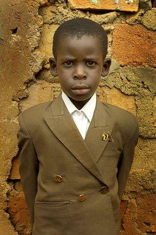 Boy in a smart jacket, Eden Slum, Kampala, Uganda