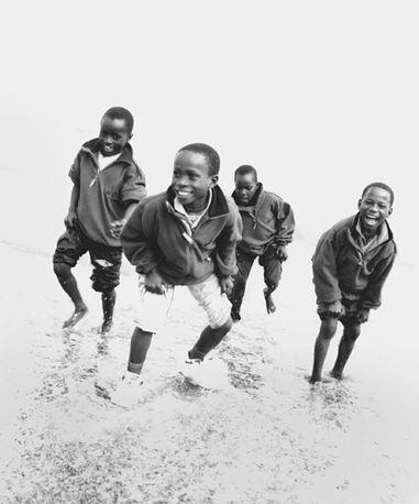 Boys on the beach, Newcastle County Down, Northern Ireland